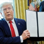 US-President-Donald-Trump-displays-an-executive-order-imposing-fresh-sanctions-on-Iran-in-the-Oval-Office-of-the-White-House-in-Washington-US-on-24-June.-REUTERS